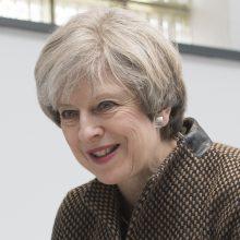 """Premjerės Th. May kova už """"Brexit"""" grįžta į parlamentą"""