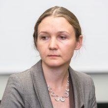 Nepatenkinamai įvertinta migracijos vadovė švenčia pergalę teisme