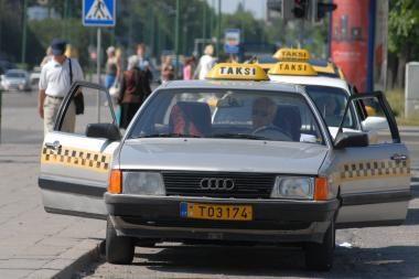 Keleiviai apvogė taksistą