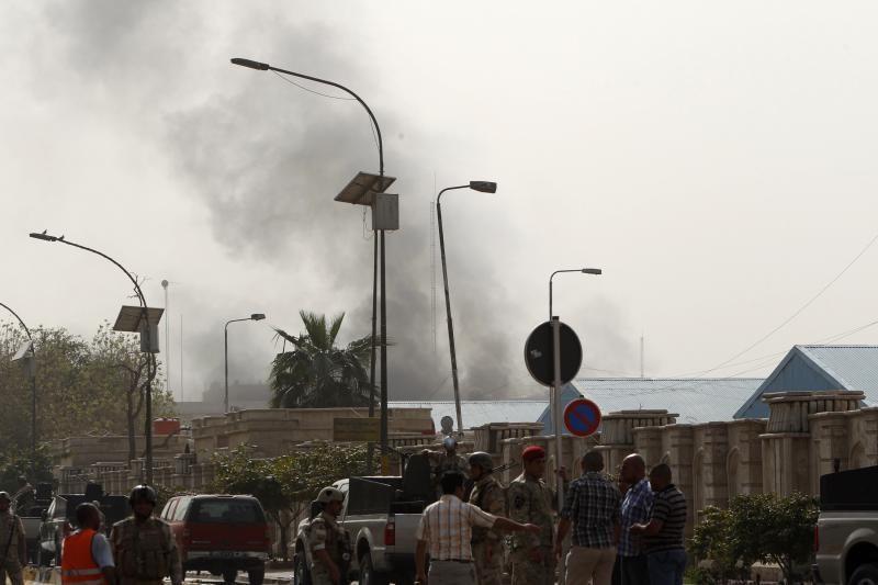 Bagdade per sprogimus ir ministerijos užpuolimą žuvo 18 žmonių