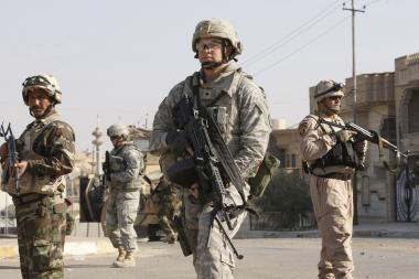 Bagdade per tris sprogimus žuvo mažiausiai 12 žmonių