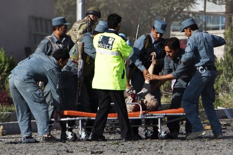 Afganai protestuoja prieš kruviną JAV kario išpuolį