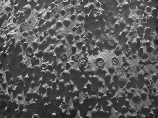 Kokiomis pūslėmis Marse išbėrė marsaeigio nufotografuotą akmenį?