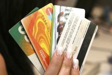 Mokėjimo kortelės siūlo šimtus nuolaidų, dalis verslininkų pirkėjų pagausėjimo nepastebi