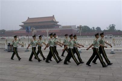 Dulkių miglą Pekine išsklaidė lietus