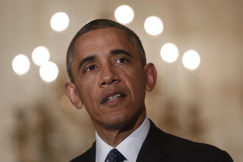 B. Obama nenori parodomojo fotografavimosi su N. Mandela