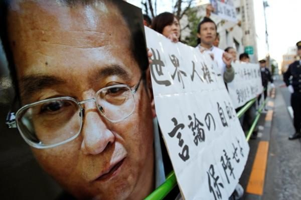 Prieš Nobelio ceremoniją priešais JT biurą Pekine surengtas protestas