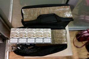 Baltarusė kontrabandines cigaretes vežė kompiuterių krepšiuose